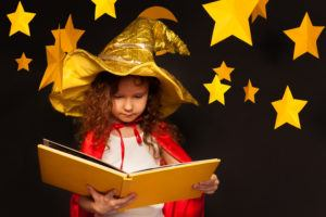 Girl reading book in hat